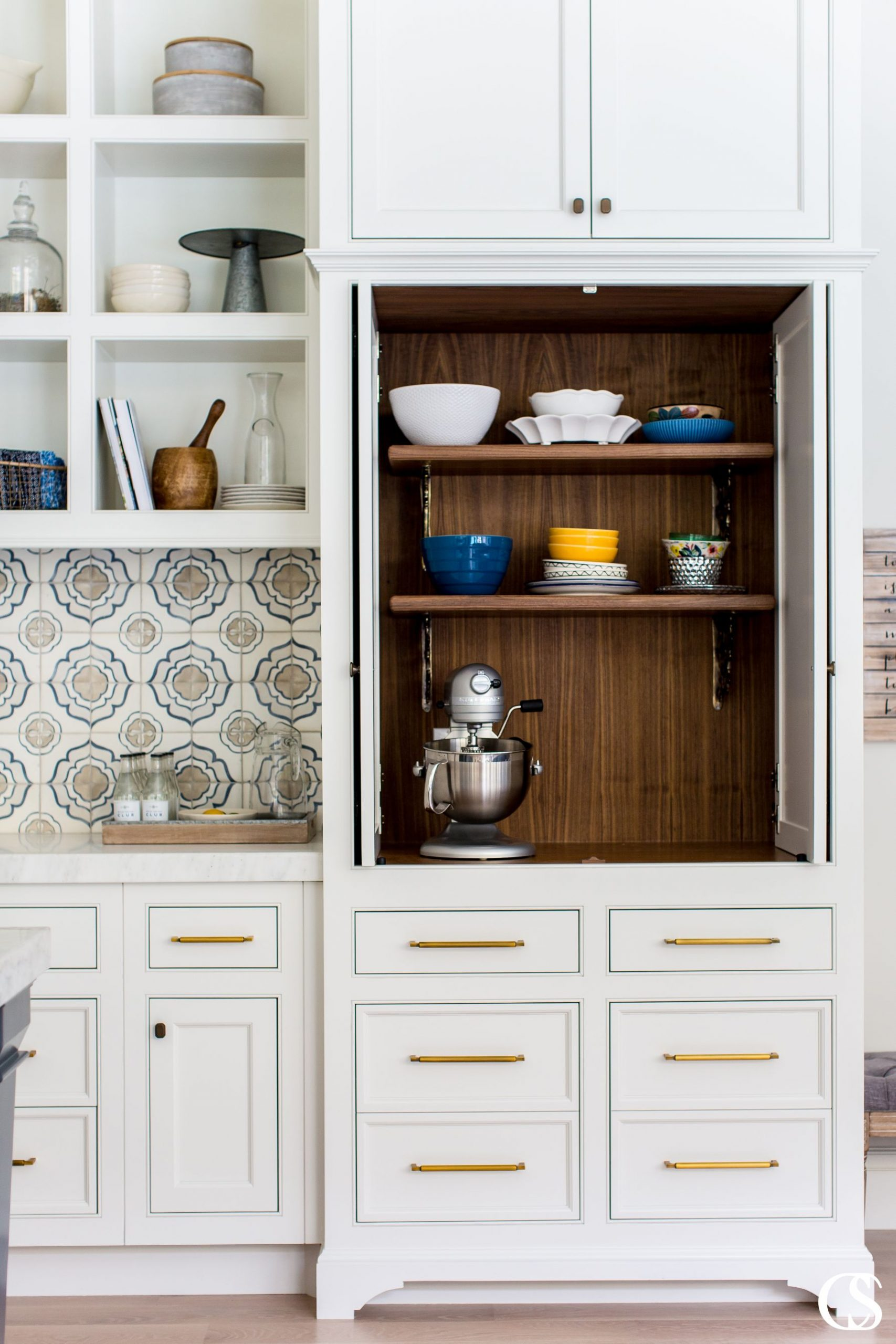 This unique kitchen cabinet design conjures memories of a vintage kitchen while offering complementary modern elements to balance out the look. Dare you not to dream of that custom tile backsplash!