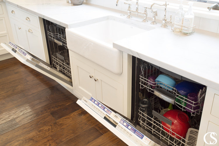 Going custom means getting unique kitchen cabinets that serve your exact needs—like hiding a set of dishwashers surrounding the farmhouse sink.