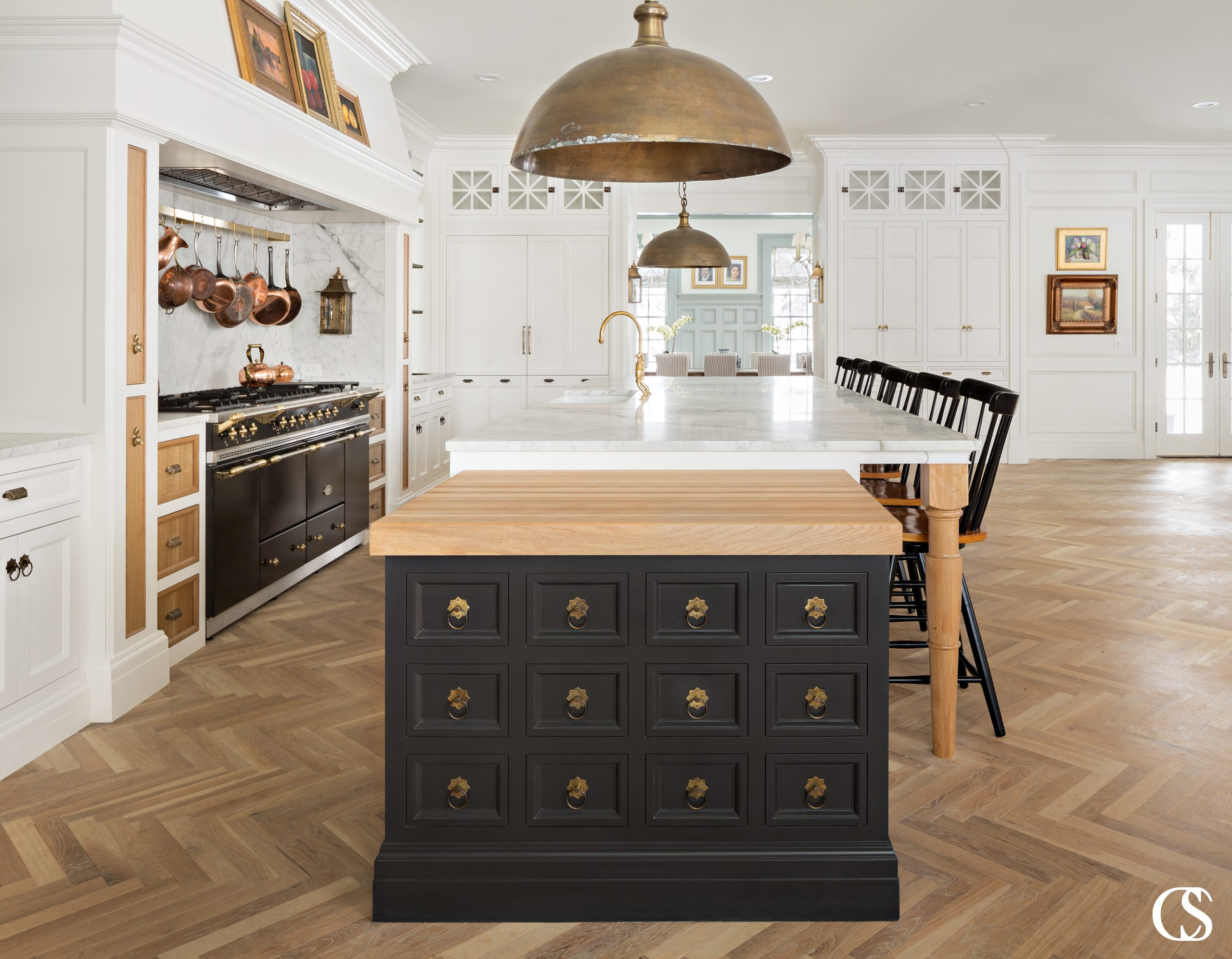 A kitchen island can have a powerful impact on your home. This unique kitchen island design combines multiple colors, materials, and global influence to reflect a beautifully eclectic style.