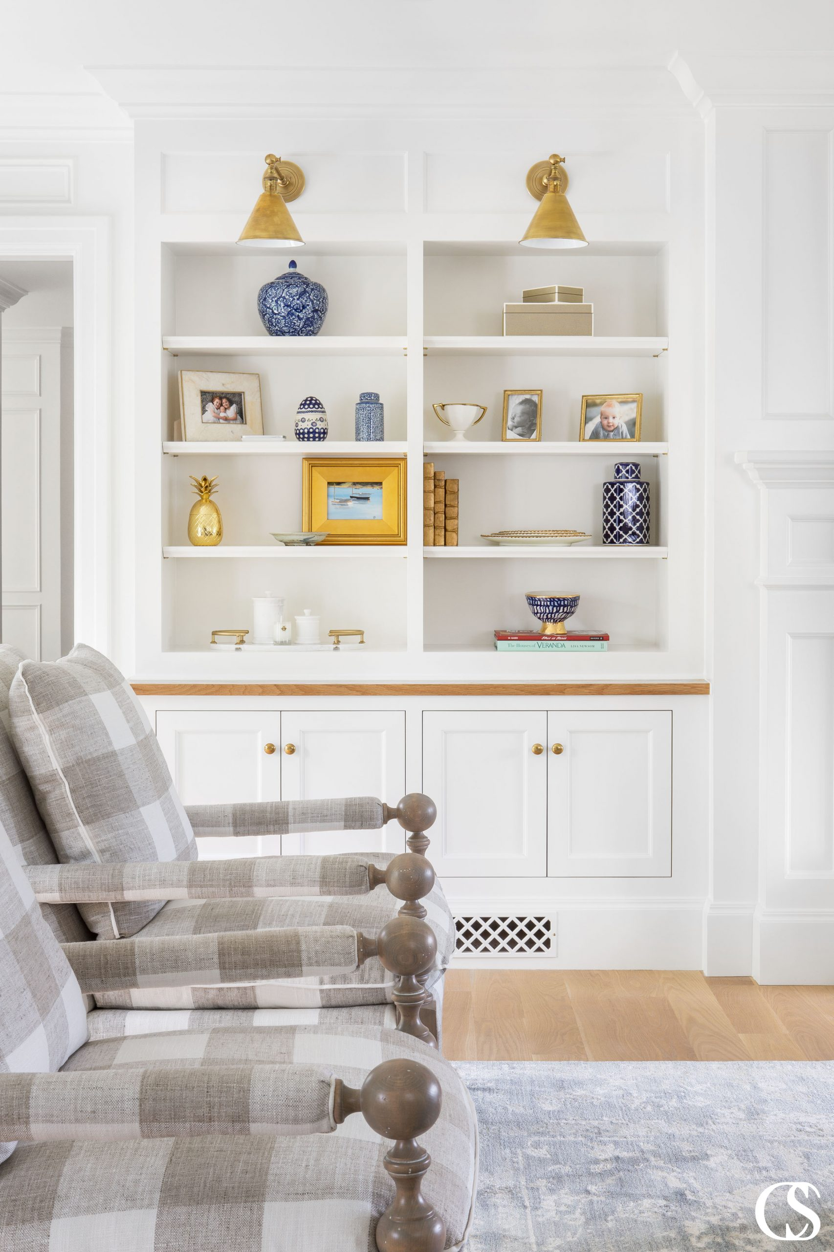 Custom cabinets for the home ensure your family has enough space for YOUR needs—like displaying beloved photos and memorabilia above hidden storage for blankets and games.