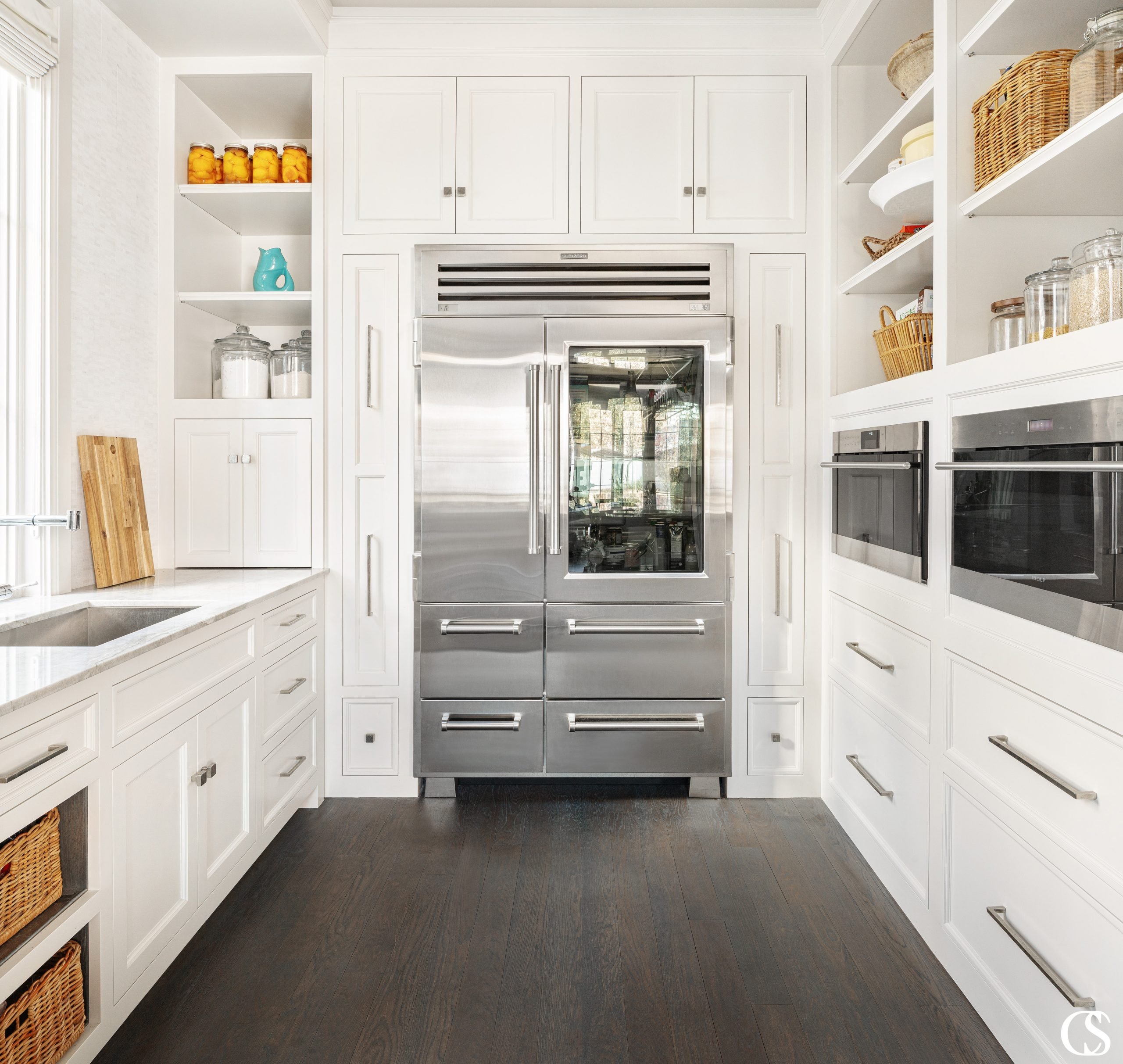 What would you store in the custom kitchen cabinets that surround the refrigerator??