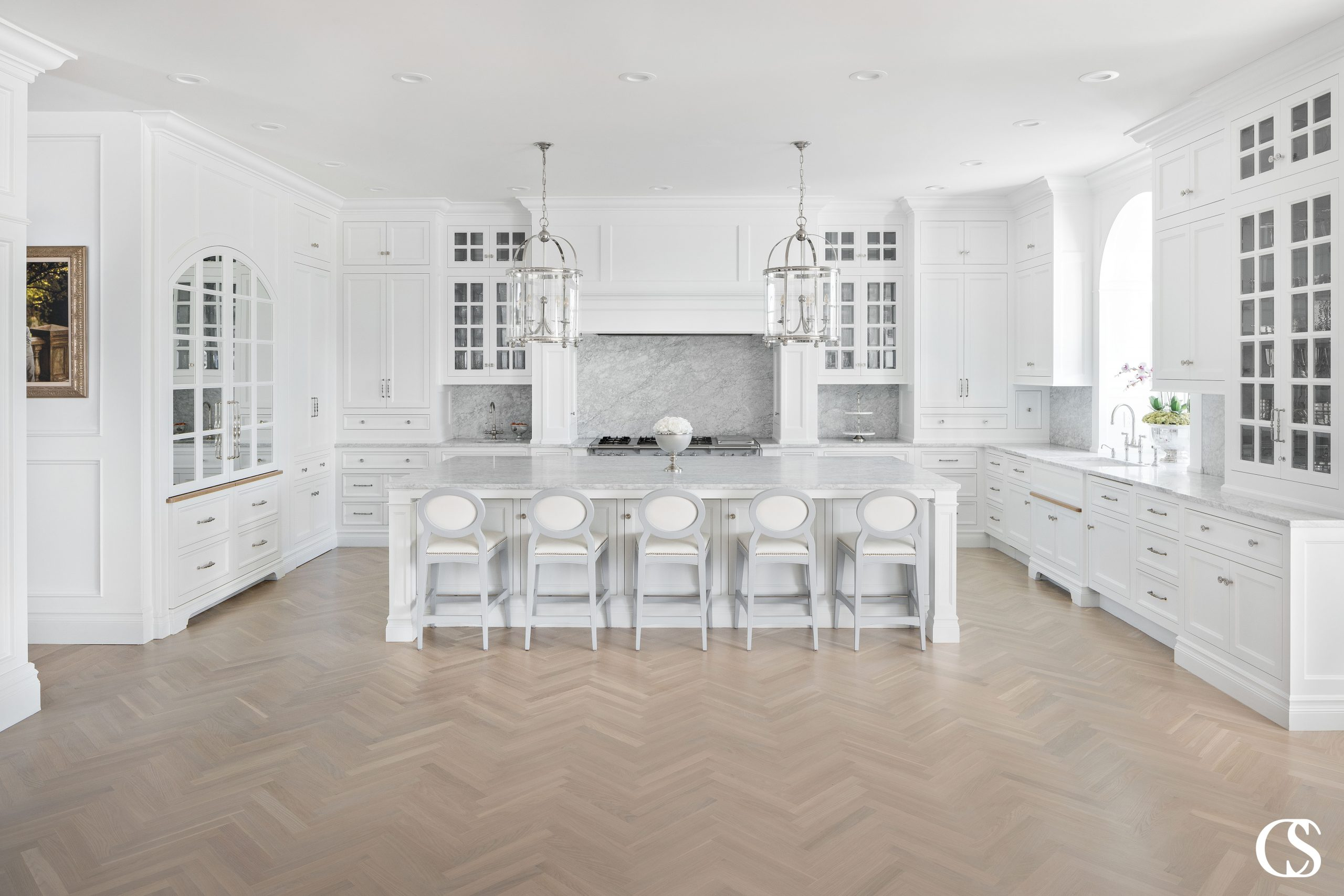 There are so many options for cabinetry and design—this white custom kitchen is full of so many custom design touches that give it a luxurious feel.