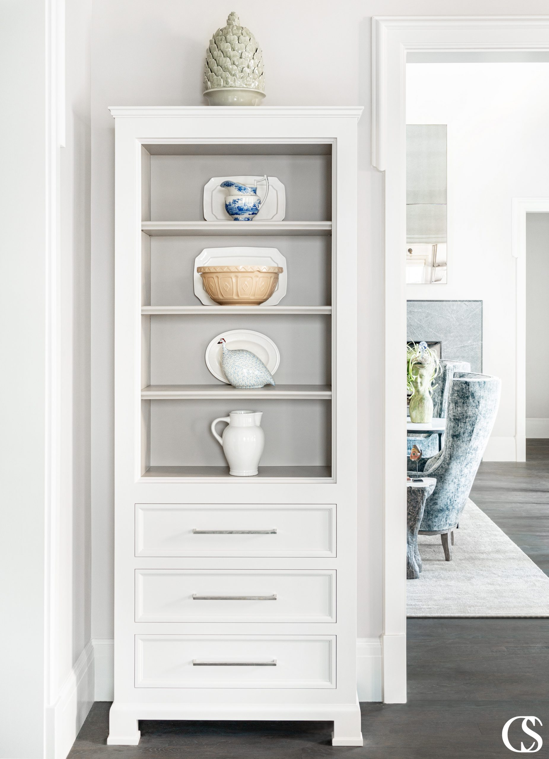 We leave no corner of our custom kitchens unturned. Even in the space between two doorways, there is room to add storage and bring the space to life.